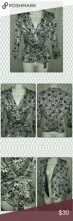 """TIE UP BLAZER!! Super light weight silver and black tie up blazer sheer sleeves and cut flowers design. Waist is fully adjustable due to the lovely tie. Length is 23"""" sleeves are 18""""  Shoulder pads. 66% polyester 34% rayon. Lining is 100% polyester ONYX nite Jackets & Coats Blazers"""