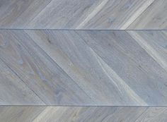 In the Chevron pattern, the wood blocks meet point to point, creating a continuous zig zag.