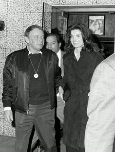 theratpacklover:  Frank Sinatra and Jackie Kennedy leaving Jilly's, 1974