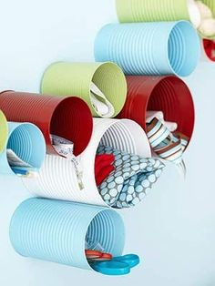 Old soup cans + spray paint = Wall storage & whimsical decoration. >> What a fun idea, great for a home studio or kids space. #DIY