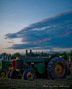 """""""Sunset"""" These tractors were parked in a field at Clark's Farm in Bedford as part of an antique tractor auction. As I turned the corner, I had to stop to snap this picture. Bedford, NH. Photographer: Dan Villeneuve"""