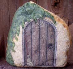Paint a little door on a rock