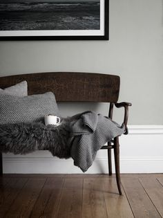 Love the clean simplicity and textural greys  with well-lived wood