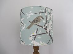 A personal favourite from my Etsy shop https://www.etsy.com/uk/listing/236817308/drum-lampshade-emily-burningham-bird