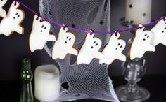 Halloween party decor - Ghost bunting made out of iced biscuits!