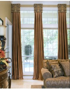 Little box cornices draw your eyes up while the drapery panels pull your eye down to the floor. Wonderful idea. See more window treatments at www.yoursbydesign.net