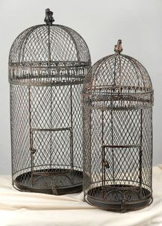 This is a set of two cages. These Large Wired Pigeon Bird Cages have removable bottom trays and a brass bird finial on the top of each. The top opens easily. Thelargest cage tall x wide and the smaller birdcage is tall x wide.