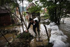 A man carries a bag during floods in Potocari, near Srebrenica. The eastern part of Bosnia has been flooded for the last two days and about 600 houses are underwater according to local media.    Dado Ruvic/Reuters
