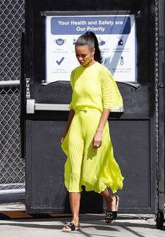 Thandie Newton in pleated neon dress and sandals | For more style inspiration visit 40plusstyle.com