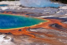 The largest hot spring in Wyoming's Yellowstone National Park is a hyper-colorful spot that measures approximately 370 feet in diameter and more than 121 feet deep.   - HouseBeautiful.com