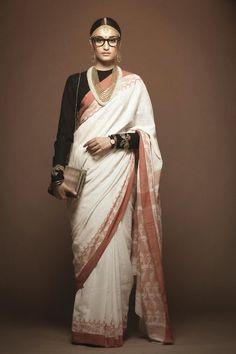 sabyasachi mukherjee white saree gold border black blouse print ad