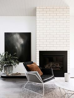 minimalist living room with grey velvet chair                                                                                                                                                                                 More