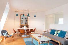Salon rénové dans un style rétro, vintage, scandinave par Maéma Architectes