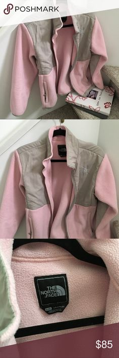 The North Face Pink Zip Fleece Jacket Great North Face pink with gray fleece zip up jacket. Size youth L fits like an adult XS perfectly. Gently used! Has some pilling on inside and could use a dry clean but no damage or stains! ''Tis the season for jackets! North Face Jackets & Coats
