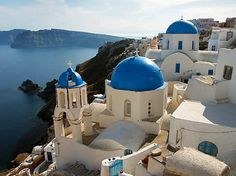 The Greek island of Santorini...I'm obsessed with those little white and blue houses.