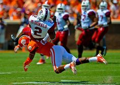 South Carolina State wide receiver Tyler McDonald is upended by Clemson's Garry Peters. (Richard Shiro/AP)