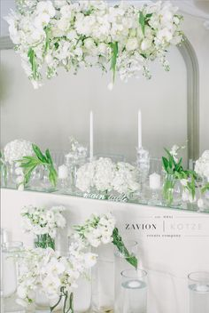 Bridal Table - White wedding flowers in huge arrangements, crisp white and green wedding. Banquet tables with floral runners, elegant wedding. Luxury wedding.