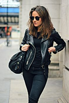 Via Just The Design: Amy Spencer is wearing a black All Saints leather jacket with Topshop skinny jeans and a black Mulberry handbag