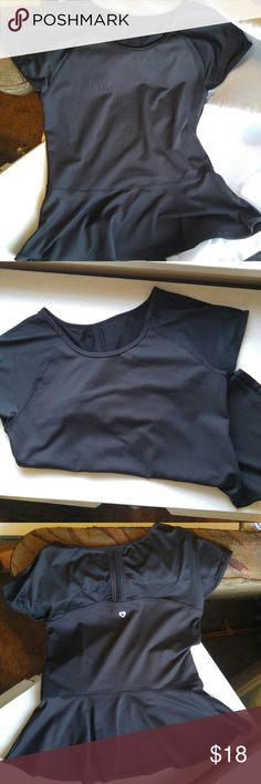Black ruffle athletic top M Black athletic short sleeved shirt by Colosseum. Size medium. Peplum ruffle at bottom. Airy fabric on sleeves and upper back to keep you cool. It has a thicker stretchy lycra-like fabric for rest of the shirt. It is a pretty take on the plain workout t-shirt.  I wore it once but the ruffle flew up everytime I jumped high for the frisbee durring Ultimate games. It's great for running, biking, lifting, yoga, dance, play, gym, or outdoors! Colosseum Tops Tees - Short…