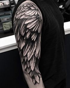 ▷ ideas for an angel tattoo and infos about the popular .- ▷ 1001 + Ideen für ein Engel Tattoo und Infos über die populärsten Designs wings tattoo ideas, man with big blackwork tattoo on the upper arm, tattoo on his arm, many feather - ideen engel Wing Tattoo Men, Wing Tattoos On Back, Wing Tattoo Designs, Upper Arm Tattoos, Broken Wings Tattoo, Wings Tattoo Meaning, Tattoos With Meaning, Tattoo Wings, Angel Wings Tattoo On Back