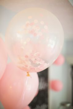 Gorgeous blush pink confetti balloons next to solid pink ones.
