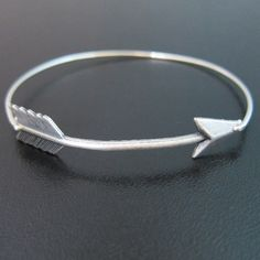 just bought. Curved Arrow Bangle Bracelet Silver Arrow by FrostedWillow on Etsy,