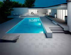 The swimming pools are a part of modern lifestyle these days. Everyone wants to get a pool at home t Stone Around Pool, Piscina Rectangular, Casa Top, Moderne Pools, Outdoor Tiles, Outdoor Pool, Swimming Pool Designs, Modern House Design, Contemporary Design