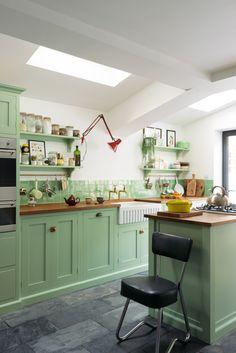 Pea green cupboards and warm wooden worktops in Rachel Khoo's delightful little deVOL kitchen at Khoolect's HQ.