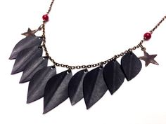 Recycled Bike Tube Leaf Necklace with Star Charms on Etsy, $26.00