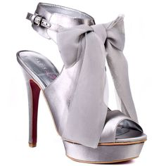 grey chiffon bow tied at the top of the heels, a silver/lavender tint on the platform, and the ankle strap thick about 1 1/2 inches stunning shoes