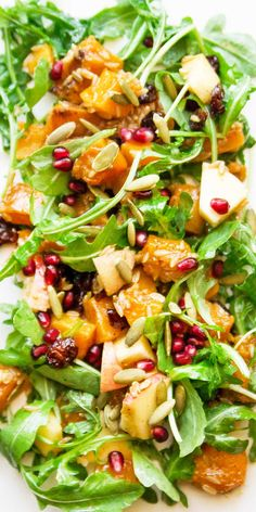Harvest Salad with Miso-Maple Roasted Butternut Squash! Toss with greens, apples, cooked grains, pepitas, dried cranberries, and pomegranate arils.