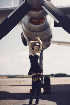 Black Dressed Woman under the Aircraft Engine - Aviation Videos & Pictures