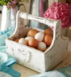 This country chic white wooden distressed egg basket is perfect for storing your breakfast eggs |