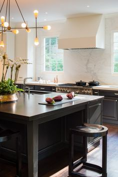modern black white kitchen design Bethesda MD marble counters backsplash apparatus studio lighting island