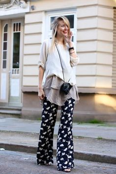 Patterned Pants: 20 Outfit Inspiration Photos - Gypsy chic outfit styled with a long sleeve top layered over a chiffon tunic, worn with black & white floral flare leg pants