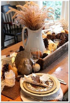 Fall table decor... Love the white ironstone pitcher filled with wheat!