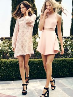 Pretty in Pink: the two models wear pastel colored dresses