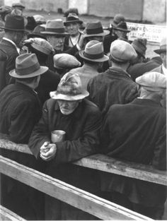 White Angel Bread Line, San Francisco, 1933 by Dorothea Lange,    This photograph shows a breadline at a soup kitchen in San Francisco, California during the depression.
