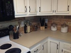 Kitchen backsplash made from recycled pallets.  Now WHY couldn't I have thought of that???