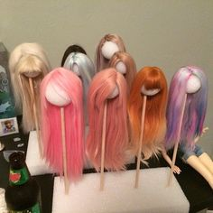 So I made a cheap wig stand last night