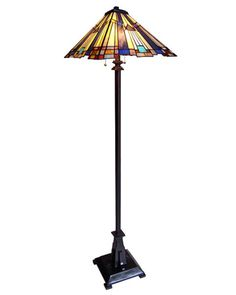 The Arts and Crafts Mission 2 Floor Lamp is 63'' tall and shade width 16''. This lamp is handcrafted with 258 pieces of high quality stained glass.