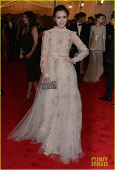 Lily Collins in a dated yet contemporary Valentino dress at the Met Gala. Really suits her look.