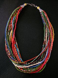 22 inches  This colorful 16-strand necklace is made of old beads from a Fulani woman's waist belt. The Fulani are a nomadic tribe from Cameroon, and these belts were typically worn under the women's skirts. The sterling silver hook and eye clasp was handmade in Sri Lanka.