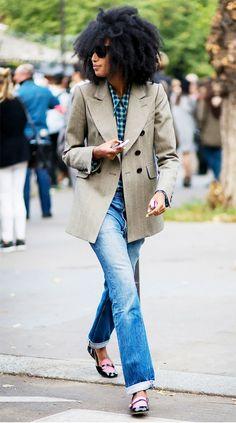 Julia Sarr Jamois rocks a sharp blazer with a plaid button-down shirt, straight-leg jeans and smoking slippers.