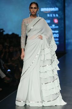 The Stylish And Elegant Ruffle Saree In Off White Colour Looks Stunning And Gorgeous With Trendy And Fashionable Georgette Fabric Looks Extremely Attractive And Can Add Charm To Any Occasion. Trendy Sarees, Stylish Sarees, Fancy Sarees, Indian Dresses, Indian Outfits, Saree Gown, Lehenga Saree, Sari Design, India Fashion