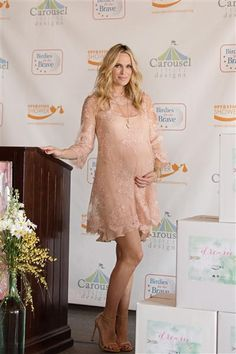 Molly Sims hosts 40 military moms-to-be from Point Mugu for Operation Shower's baby shower of a lifetime at The Riviera Country Club during the Northern Trust Open's PGA Tour tournament in Los Angeles on Feb. 17, 2015.