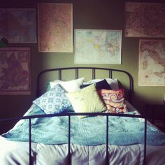 My bedroom. Olive green walls, patterned throw pillows, and lots of maps.