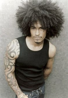 How can you not love this sunburst of #curlyhair? We've got a #frocrush on this #Naturalgent! Way to #DefineYourNatural!