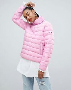 bc062807 Shop Tommy Jeans quilted over the head padded jacket at ASOS.