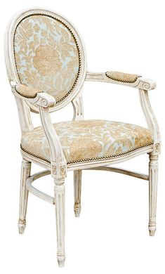 Floral Georgian Carver A wonderful chair  Reproduced from an earlier century, this beechwood carved chair is characterised by its fluted legs A horse shoe stretcher adding strength and durability to a timeless piece of furniture These chairs are made by our own craftsmen This chair is upholstered in a beautiful duck egg blue and gold floral pattern The wood is finished in barley white and gold scrumble Simply charming